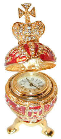 """Imperial Egg with Clock"" Exquisite Enameled Egg accented with Gold & Sparkling Clear Crystals. Topped with Gold Crown with Clear Crystals. Egg opens & has clock inside. Egg sets on 3 leg magnetic base. Available in Purple (P) or Red (R)"