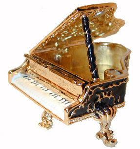 ?Piano Jeweled Box ? Gold tone enamaled trinket box accented with clear crystals. Available in Black, Brown and Red.