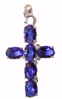 """Sterling Silver Cross Blue CZs"" Sterling silver cross set with Deep Blue colored CZs. Chain included."