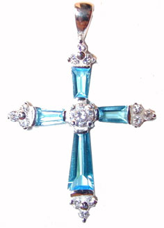 """Sterling Silver Cross Aquarmarine Accents"" Sterling Silver set with faceted Aqua colored crystals on the cross members.. Chain included."