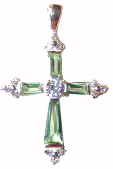 """Sterling Silver Cross - Green Tourmaline"" Sterling Silver set with faceted Green Tourmaline crystals on the cross members.. Chain included."