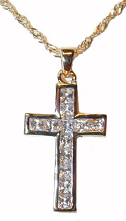 """Gold Cross"" Gold tone set with channel setbrilliant clear CZs. 16"" Chain included."