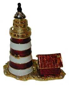Striped Lighthouse with Red House Gold tone lighthouse red and white enamel with crystal accents. House is red enamel.
