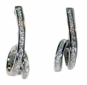 """Curly Cue"" Sterling Silver channel set with clear CZ's."